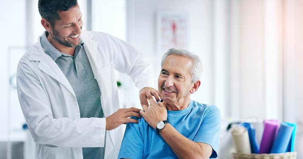 Chiropractor spending time with patient
